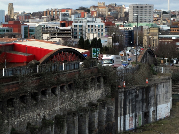Unfamiliar view of Bristol with remains of old railway workshops in foreground