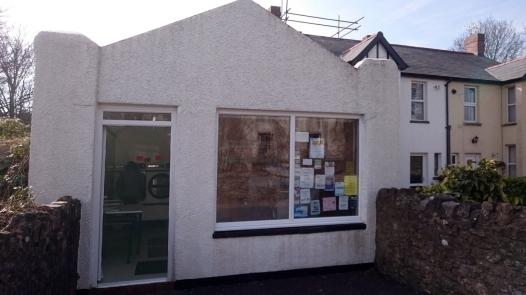 Village launderette hiding behind community notices