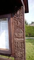 Ornate carved frame on parish noticeboard