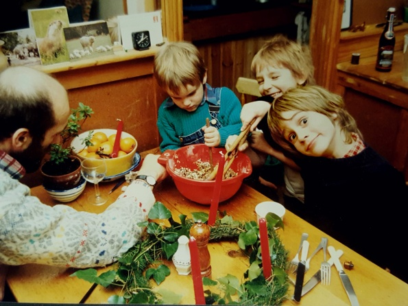 1988 Christmas pudding stir-up, oldest son far right, youngest in green, plus family friends.