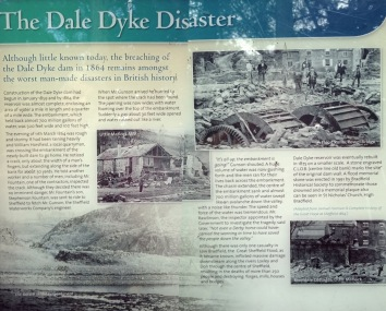 Interpretation board at the dam with the story