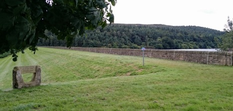 The dam wall today with a memorial monument.